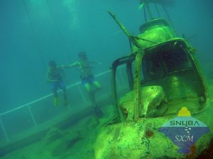 Boys looking at the sunken helicopter